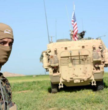 مقاتلة من الـ YPJ بجانب عربة أمريكية - WAJ